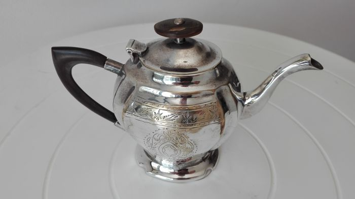 """Royal Sheffield Family"" English silver milk jug"