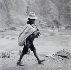 Werner Bischof (1916-1954) - A flute player on the road to Cuzco, Peru, 1954