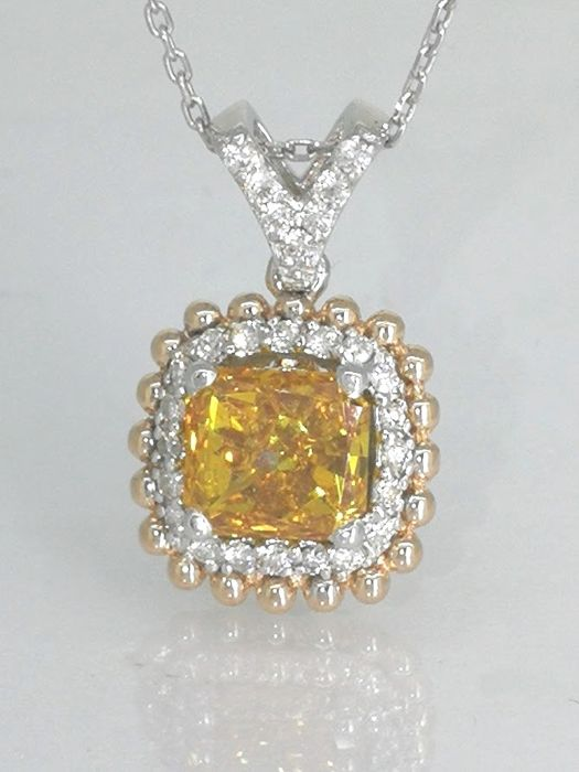 14 kt gold pendant with fancy deep yellowish orangy colour diamond 1.00 ct & 27 diamonds