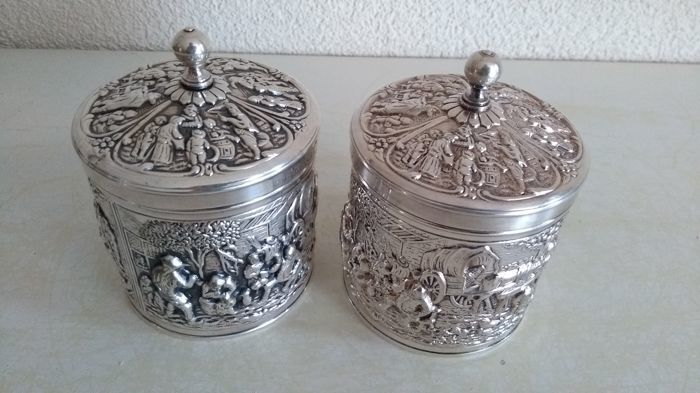 Two identical silver-plated tea cans Douwe Egberts made by Herbert Hooijkaas. - Silverplate