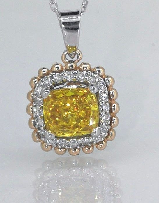 Pendant with a fancy deep yellowish orangey colour diamond, 0.80 ct & 20 diamonds ***No reserve price**