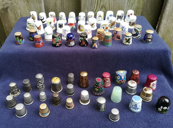 65 various thimbles including some silver ones