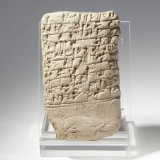 Cuneiform tablet with inscription on one side.  7 cm