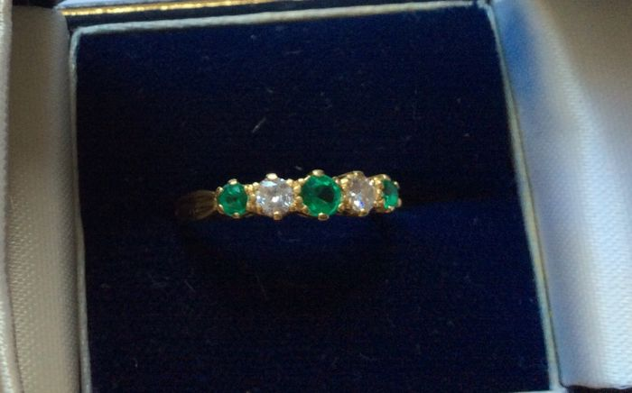Diamond and created emerald 18 carat ring.