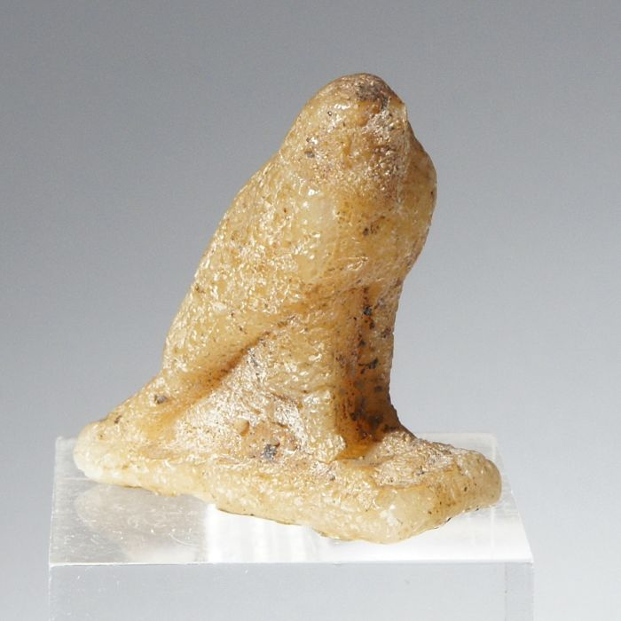 A bee wax amulet of a falcon. Egypt,  3 cm Egypt, Late Dynastic Period (or earlier)