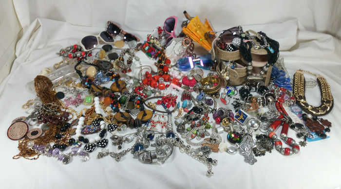 A collection of new and vintage pieces of costume jewellery - over 150 pieces in silvery and golden metal, natural stones, murrine glass, Swarovski, etc.