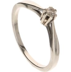 4dabf029bdcb 14 kt White gold solitaire ring set with a brilliant cut diamond of approx.  0.06
