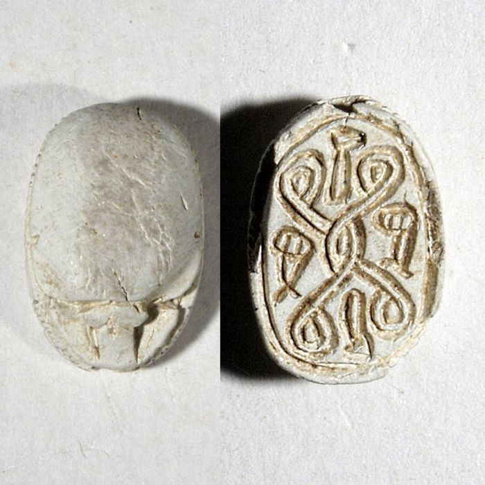 Steatite scarab with hieroglyphic signs. 1,5 cm   Egypt, 2nd Intermediate Period, 1785-1580 B.C.