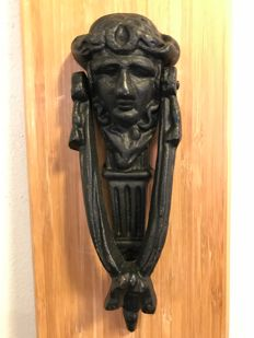 Beautifully ornamented cast iron door knocker with the face of Artemis, circa 1970