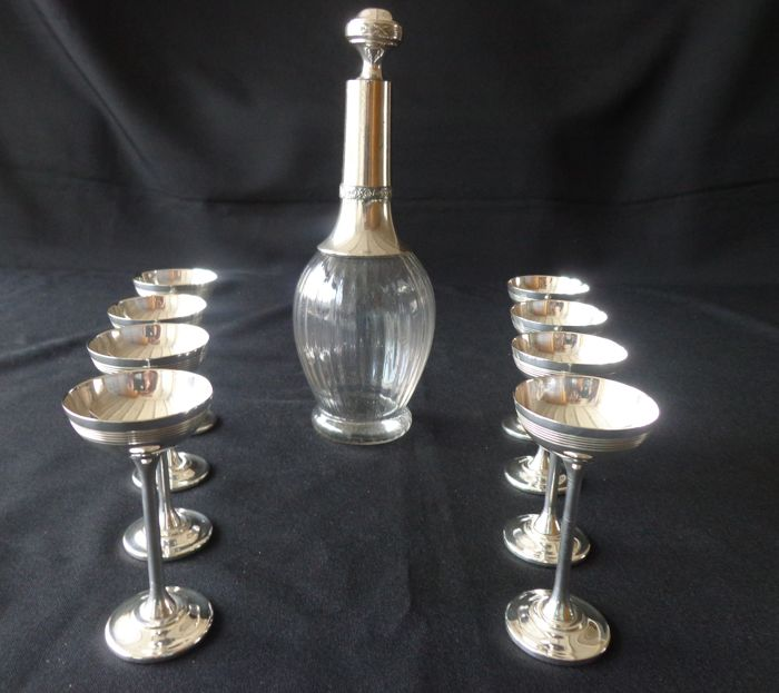 8 silver plated liquor cups and 1 decanter with silver plated parts