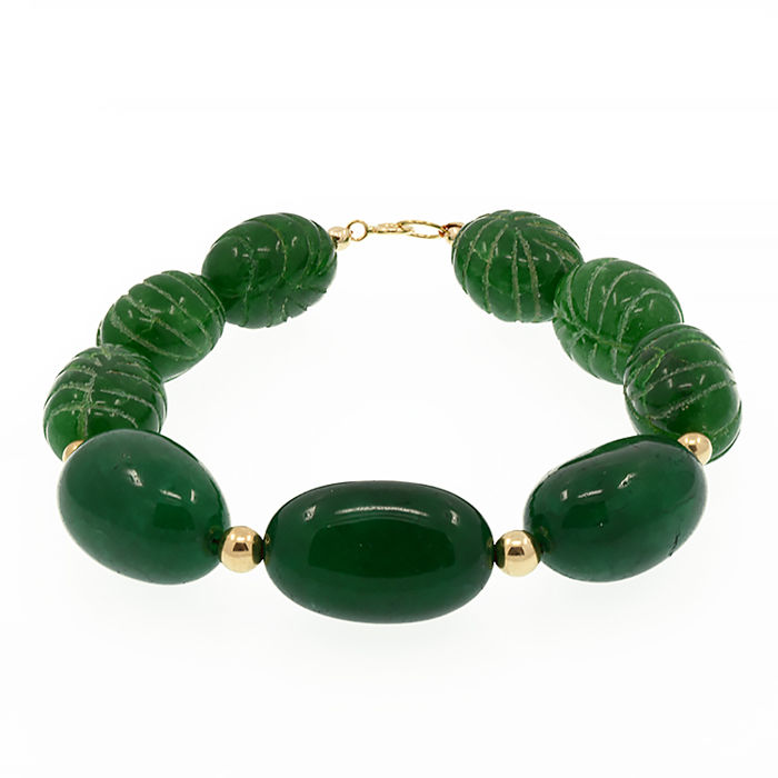 18k/750 yellow gold bracelet with carved emeralds. - Length 20 cm.
