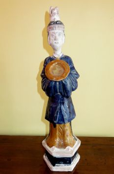 A large Chinese sancai-glazed model of a servant on base – Ming Dynasty