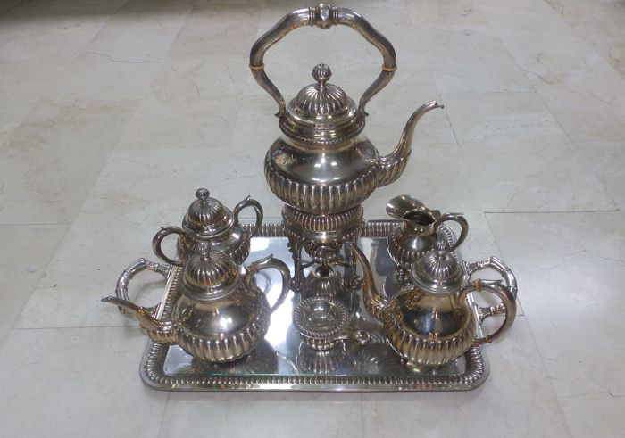 Complete coffee set, fluted, seven pieces, in silver. Spain. 20th century