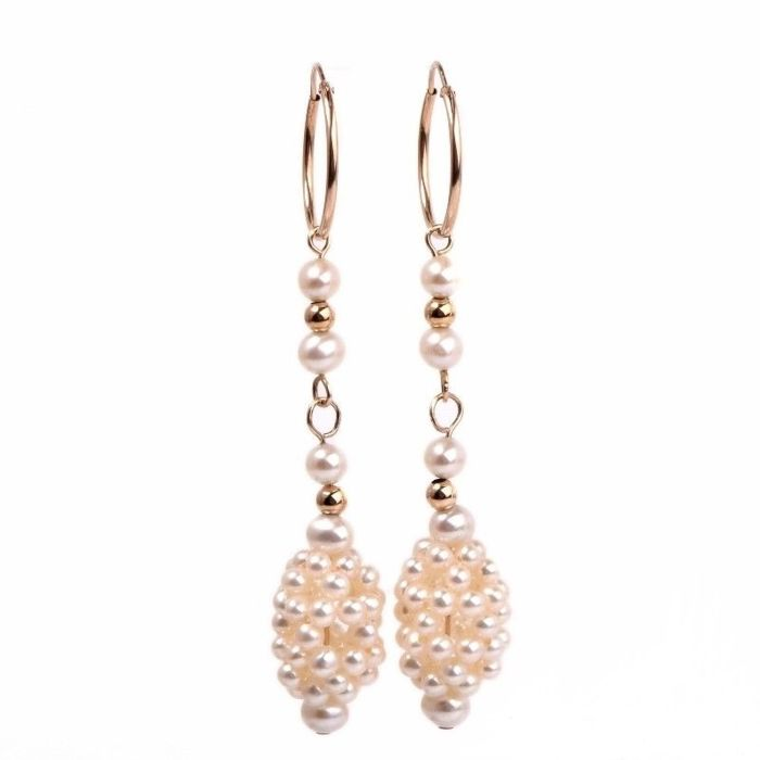 Long gold dangle earrings with pearls