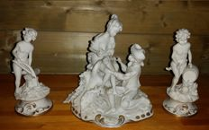Three piece set of an antique biscuit porcelain sculpture group Capodimonte mark