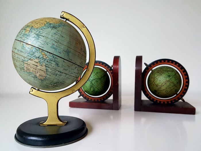 1 old metal globe and 2 wooden bookends with globe