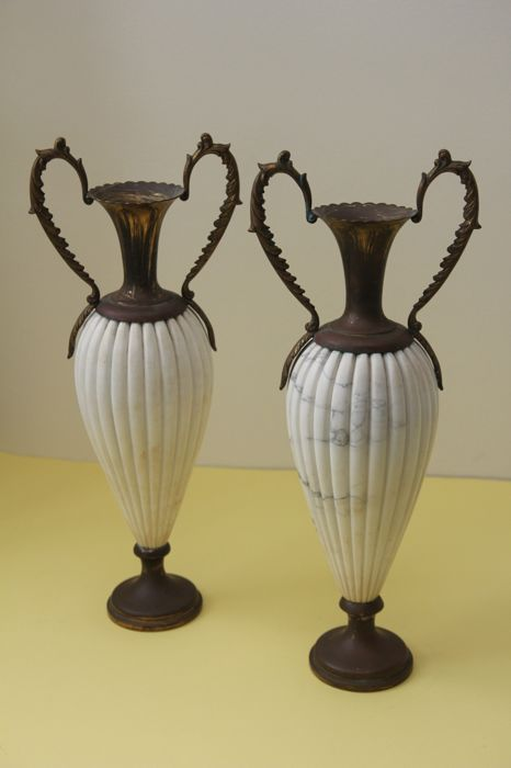 A pair of bronze and Carrara marble vases, Italy, 1920s