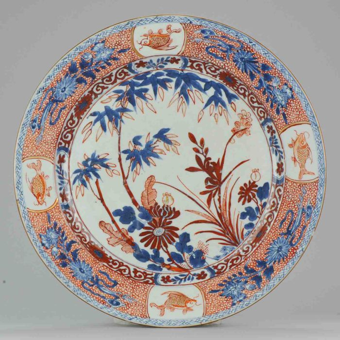 Porcelain export charger with fish clobbered decoration - China - 18th century