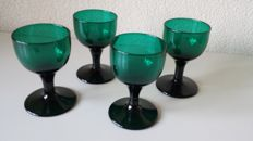 Four wine glasses in green glass, England, mid 19th century