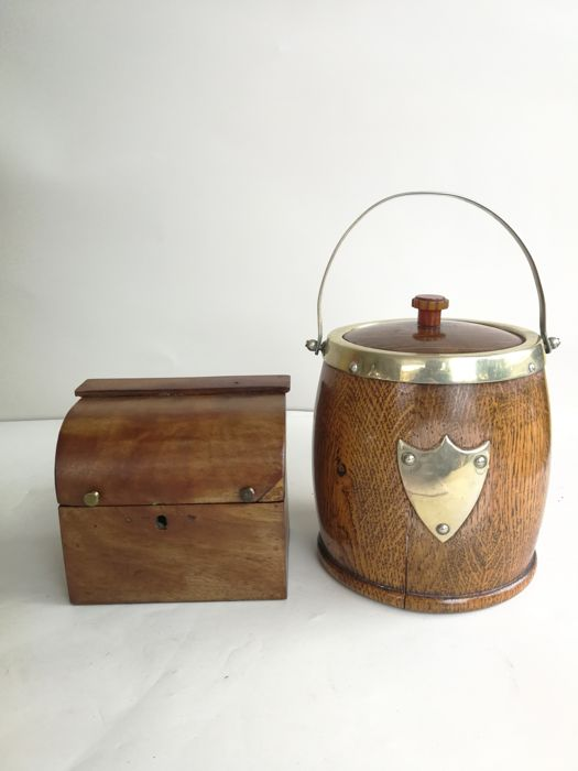 An antique wooden tea caddie and a wooden ice bucket with silver plated decorations - inside made of ceramic - England - mid-1900
