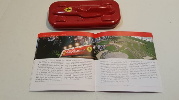 Original ARTENA pen made on Ferrari license with metal case shaped like a race car + Ferrari Day guidebook