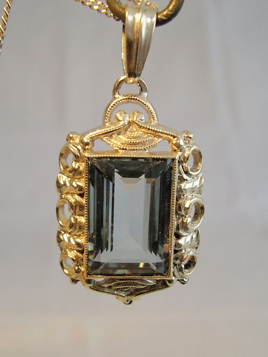 Art Deco pendant with light blue spinel in rectangular cut weighing 16 ct on a silver chain