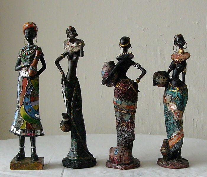 Four magnificent porcelain figurines of African women