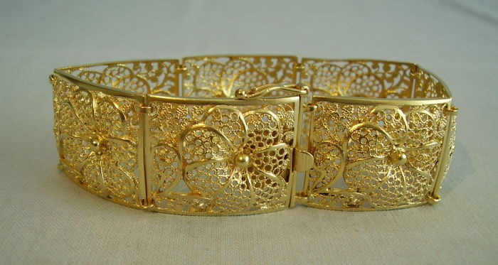 antique Victorian bracelet in a filigree execution with a large flower pattern