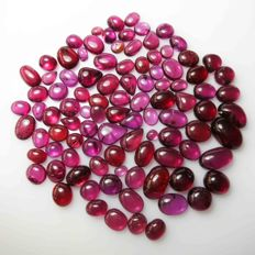Lot of purple red rhodolite garnet cabochons - 257.0 ct (98pcs)