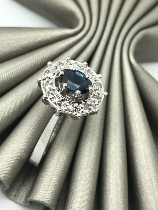 14 kt white gold sapphire ring with diamond accents; size approx. 58