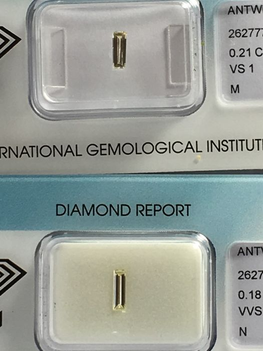 Pair of brilliant cut diamonds totalling 0.39 ct M-N VVS2-VS1 with IGI certificate