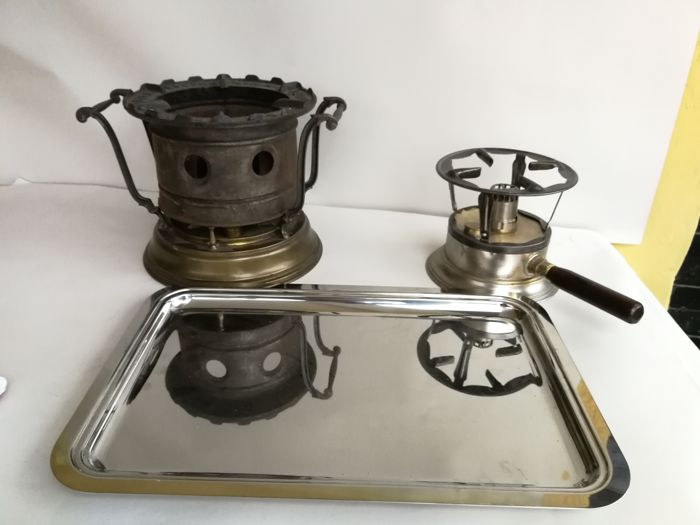 Pair of antique flambé burners, one plated with English silver and the other, which is an alcohol burner, made of brass and cast iron. From the late 1800s/early 1900s plus silver-plated tray