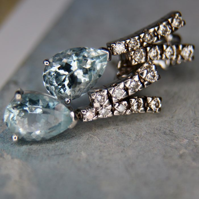 75/18kt. White gold stud earrings (handwork) set with drop cut beautiful natural Aquamarine and brilliant cut diamonds H/VS; total 3.50Ct. Excellent state.