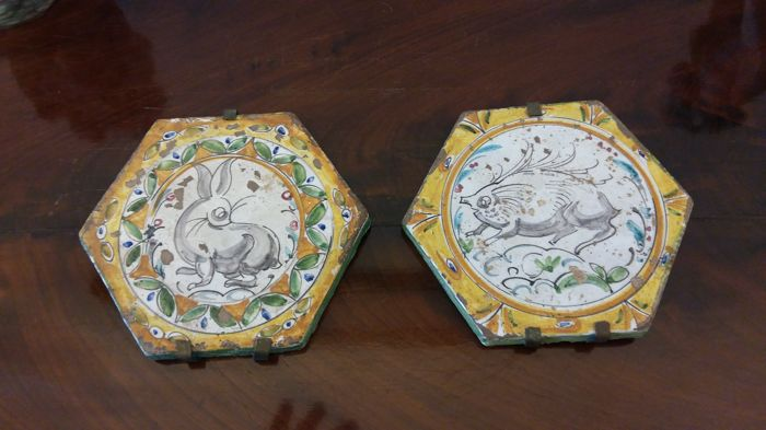Two hexagonal tile painted with animals, Neo-Renaissance style Manifattura Molaroni.
