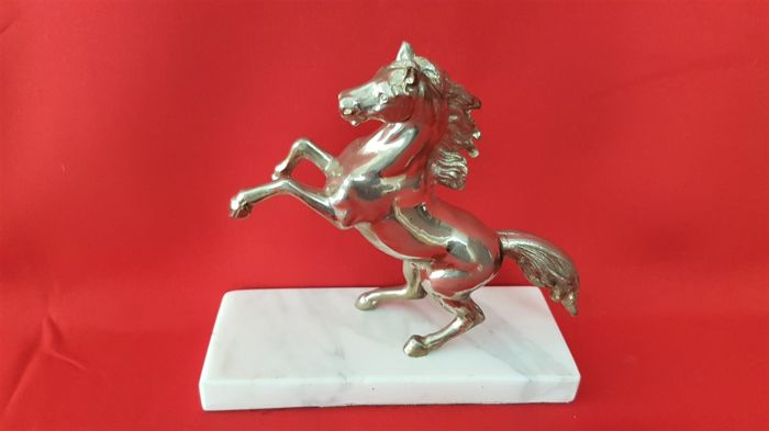 Silver-plated sculpture of a prancing horse - based on Ferrari