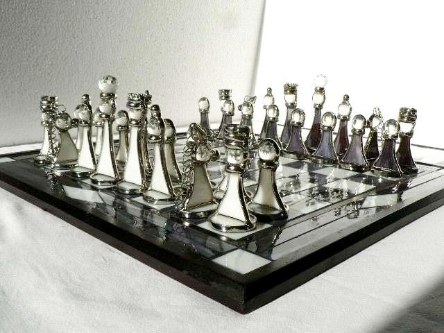 Chess set made of glass and nickel-plated tin