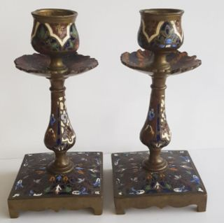 A pair of brass, onyx and Champlevé enamel candlesticks, France,  Early 20th century