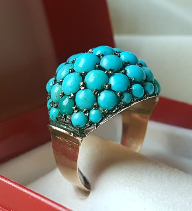 14 karat gold ring with the form of a women's signet with turquoise from the late 19th century.