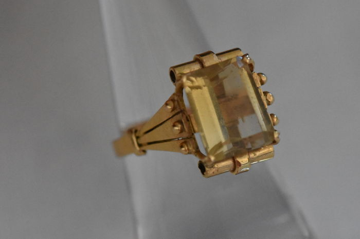A unique art deco , yellow gold 18 ct ring , set with a yellow natural topaz, weight 6 gr. size 58