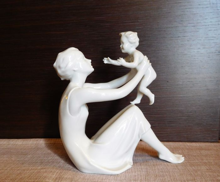 A large KAISER porcelain statuette of mother and infant
