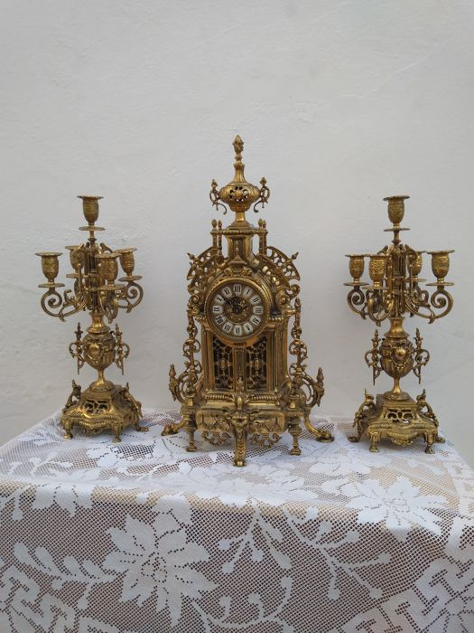 Large bronze clock with matching candelabra