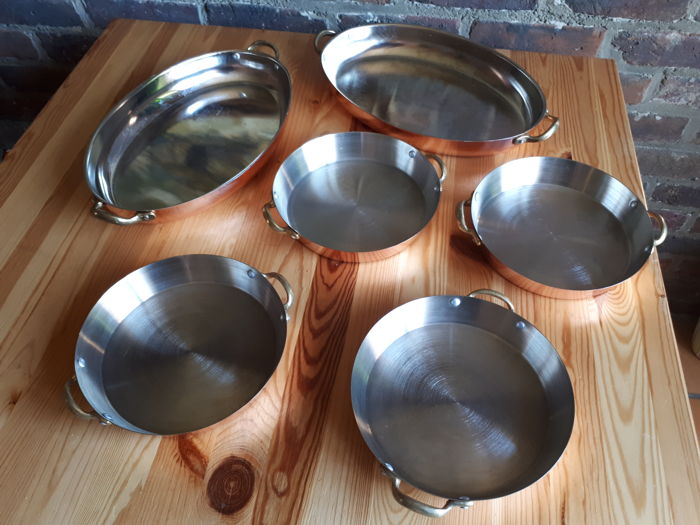 4 pans and 2 kitchen dishes made of copper and stainless steel