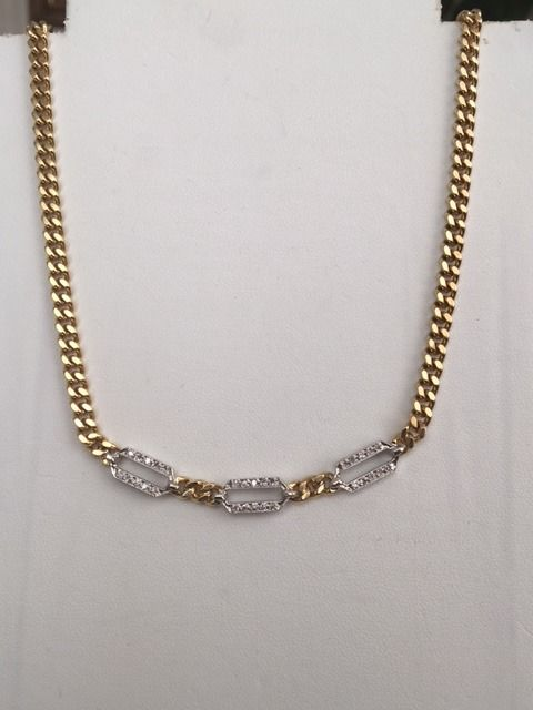 18 kt white and yellow gold necklace, set with diamonds of approx. 0.30 ct in total.