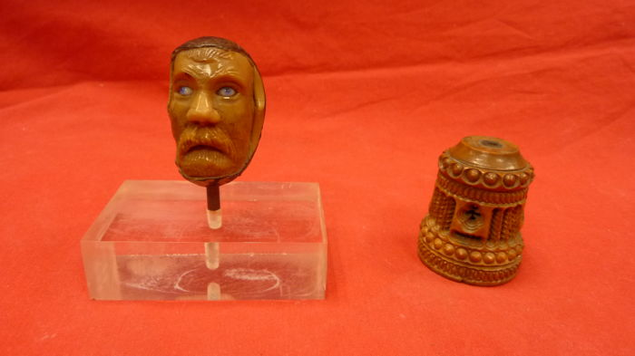 Sculpture of a grotesque head and a piece of boxwood from the 19th century