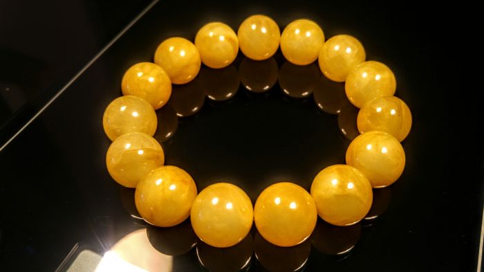 Egg yolk colour Baltic amber bracelet, hole ca. 60 mm, 34 grams