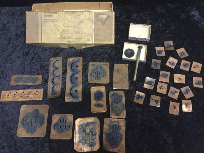 Large historical collection copper stencils around 1900 for monograms in original box