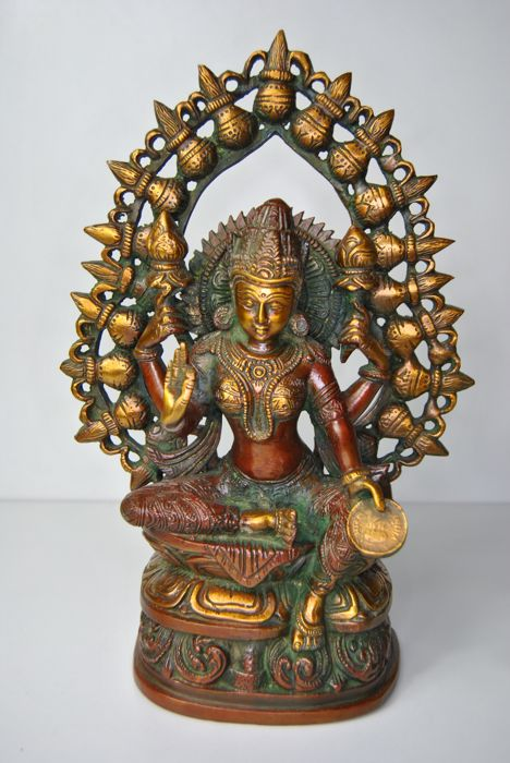 Bronze Lakshmi with coin - India - late 20th century (27 cm)