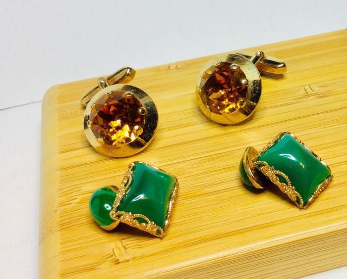 Two pairs of vintage cuff links with gem stones