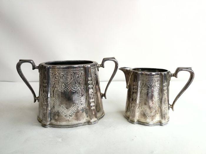 Beautiful silver plated set of sugar bowl and milk jug with floral decoration