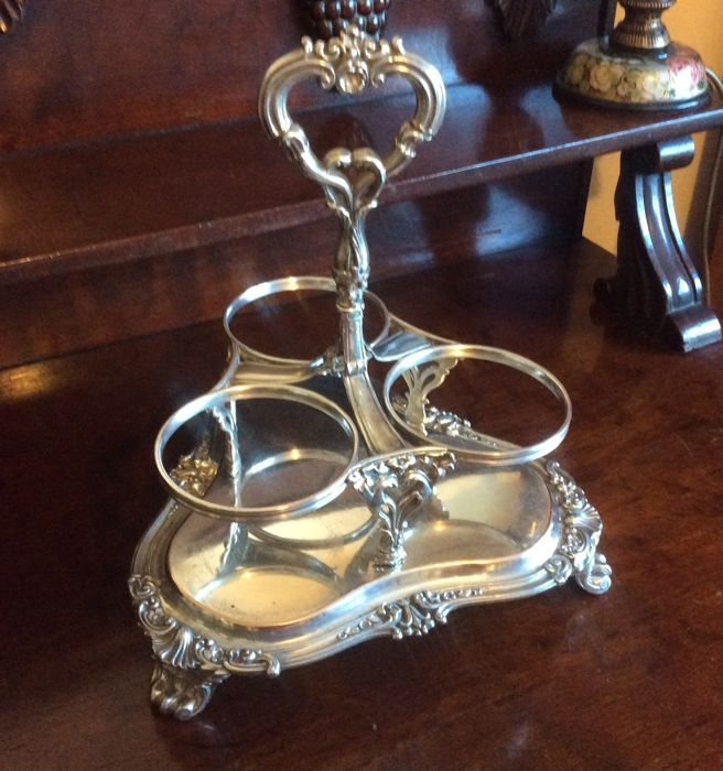 Silver plated three wine bottle carrier/ holder